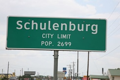 The city proper starts and ends at the city limits, as seen with this sign for Schulenburg, Texas.