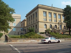 Summit County Courthouse and police car. The modern police car originated in Akron in 1899.[19]