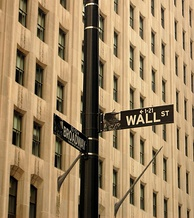Not just a metonym, Wall Street also has its own street sign.