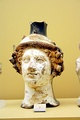Terracotta vase in the shape of Dionysus' head (circa 410 BC) - on display in the Ancient Agora Museum in Athens, housed in the Stoa of Attalus
