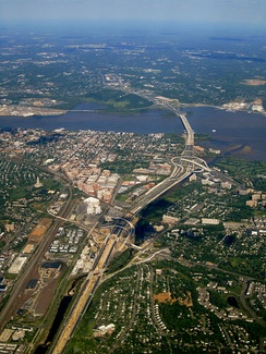 The southern portion of the Capital Beltway along the Potomac River, featuring portions of Washington, D.C., Maryland, and Virginia.  Old Town Alexandria, Joint Base Anacostia-Bolling, and National Harbor, Maryland are visible.