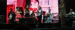 Romanian singers Rona Hartner, Paula Seling, Nico and Maria Radu performing at a memorial Amy Winehouse concert in Bucharest on 23 October 2011