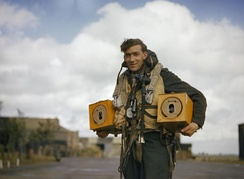 Crewman with homing pigeons, 1942. Pigeons were customarily carried aboard Lancasters as a means of communications in the event of a crash, ditching or radio failure.