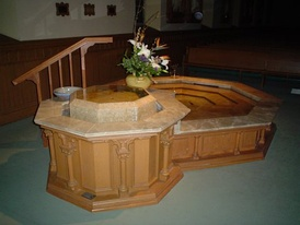 "The baptistry at St. Raphael's Cathedral, Dubuque, Iowa. This particular font was expanded in 2005 to include a small pool to provide for immersion baptism of adults. Eight-sided font architectures are common symbology of the day of Christ's Resurrection: the ""Eighth Day""."