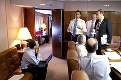 President Barack Obama meets with staff mid-flight aboard Air Force One, in the conference room, 3 April 2009.