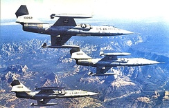 Three West German Air Force Lockheed F-104G Starfighters fly in formation over Arizona.