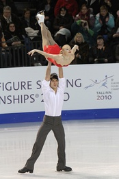 Maria Mukhortova / Maxim Trankov perform a carry lift with the man in a spread eagle