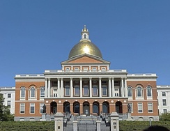The Massachusetts State House, topped by its golden dome, faces Boston Common on Beacon Hill.