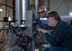 NIST physicists Steve Jefferts (foreground) and Tom Heavner with the NIST-F2 caesium fountain atomic clock, a civilian time standard for the United States.