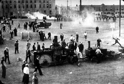 Scene during the Regina Riots. The machinery at the bottom of the frame is the city's tar-making machine, parts of which were used by rioters to throw at police during the riot.