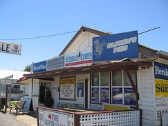 A general store in Scarsdale, Victoria, Australia operates as a post-office, newsagent, petrol station, video hire, grocer and take-away food retailer
