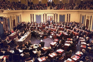 The impeachment trial of United States president Bill Clinton in 1999, Chief Justice William H. Rehnquist presiding. The House managers are seated beside the quarter-circular tables on the left and the president's personal counsel on the right, much in the fashion of United States president Andrew Johnson's trial in 1868.