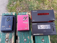 Three Walkman players, variously dating between 1984 and 1991