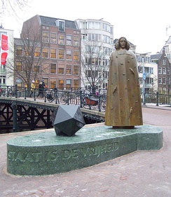 "Statue (2008) of Spinoza by Nicolas Dings, Amsterdam, Zwanenburgwal with inscription ""The objective of the state is freedom"" (translation, quote from Tractatus Theologico-Politicus 1677)."