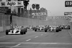The start of the race, with Ayrton Senna leading the field.