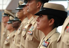 "U.S. Navy chief petty officers wearing the Service Khaki uniforms with the soon-to-be discontinued female ""bucket-styled"" combination covers in September 2006."