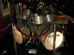 "Bass drums with ""woofers"" or additional resonating sections attached to enhance tone and depth. Drum set used by Alex Van Halen"