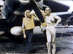 Ensign George Gay (right), sole survivor of VT-8's TBD Devastator squadron, in front of his aircraft, 4 June 1942