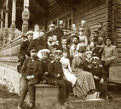 Alexander III and Maria Feodorovna in the family circle on the porch of his home in Langinkoski, Finland in summer 1889.