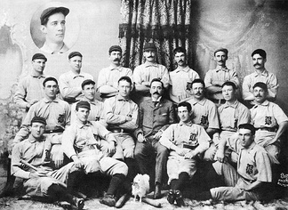 Manager Ned Hanlon (in business suit, center) with the 1896 Baltimore Orioles, including Willie Keeler (front row, to right of Hanlon, with elbow on Hanlon's knee), Hughie Jennings (2nd row, 2nd from right), Joe Kelley (left of Hanlon), and John McGraw (2nd from left, front row)