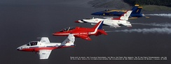 Formation composed of aircraft from the Snowbirds (CT-114), Red Arrows (Hawk), Thunderbirds (F-16) and Blue Angels (F/A-18).
