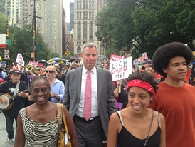 Bill de Blasio with his wife, Chirlane, (left) and children Chiara and Dante at a rally in New York City in 2013