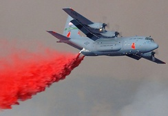 A C-130E fitted with a MAFFS-1 dropping fire retardant