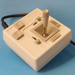 CH Products Mach 2 analog joystick as used with many early home computer systems. The small knobs are for (mechanical) calibration, and the sliders engage the self-centering springs.