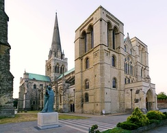 Chichester Cathedral's west front and millennium statue of Saint Richard of Chichester.
