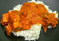 Chicken tikka masala, served atop rice. An Anglo-Indian meal, it is among the UK's most popular dishes.