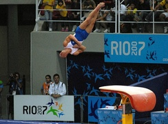 Diego Hypólito vaulting from a modern vaulting table during the 2007 Pan American Games.