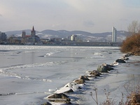 A look upstream from the Donauinsel in Vienna, Austria during an unusually cold winter (February 2006). A frozen Danube usually occurs just once or twice in a lifetime.