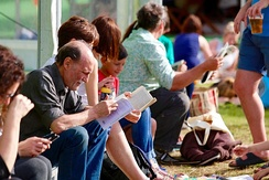 Hay Festival crowds reading between sessions