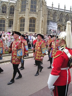 Heralds, wearing tabards, in procession to St. George's Chapel, Windsor Castle for the annual service of the Order of the Garter in 2006. (l-r) Wales Herald of Arms Extraordinary (Michael Siddons), Somerset Herald of Arms in Ordinary (David White), Maltravers Herald of Arms Extraordinary (John Robinson), York Herald of Arms in Ordinary (Henry Paston-Bedingfeld), Windsor Herald of Arms in Ordinary (William Hunt).