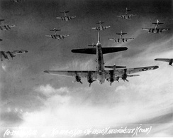 B-17 Flying Fortresses from the 398th Bombardment Group flying a bombing mission to Neumünster, Germany, on 13 April 1945.
