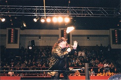 Heyman addressing the crowd at an ECW television taping in 1999