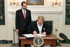 Donald Trump signs the Coronavirus Preparedness and Response Supplemental Appropriations Act into law with Alex Azar on 6 March 2020.