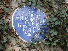 An English Heritage blue plaque marks where Hitchcock lived at 153 Cromwell Road, Kensington, London.