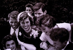 The newlyweds surrounded by Jack's siblings on their wedding day in Newport, Rhode Island in 1953