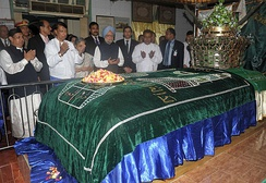 Prime Minister of India Manmohan Singh prays at the Mazar of Bahadur Shah Zafar, in Yangon, Myanmar