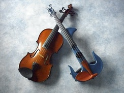 A standard violin and an electric violin with a cut-away body
