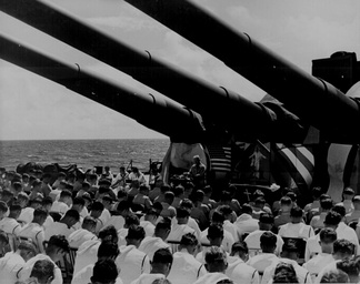 On 1 July 1944, Chaplain Lindner reads the benediction held in honor of USS South Dakota shipmates killed in the air action off Guam