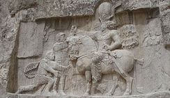 A bas-relief at Naqsh-e Rostam, depicting the victory of Sasanian ruler Shapur I over Roman ruler Valerian