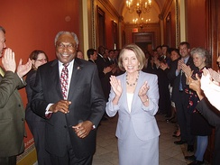 Jim Clyburn and Nancy Pelosi celebrate after the House passes the amended bill on March 21.