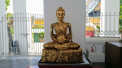 "The gilded ""Emaciated Buddha statue"" in an Ubosoth in Bangkok representing the stage of his asceticism"