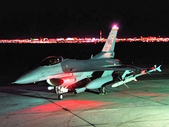 The Las Vegas Strip is visible from the Nellis flight-line with an F-16CJ.  Operation Ready Switch replaced Nellis' F-4s when the 474th was the 3rd USAF wing to receive F-16s (November 1980).[30]