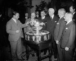Cordell Hull, flanked by, from left, Russell B. Kingman and Joseph Ward on his right, and, on his left, Homcombe Ward and Richard Dudley Sears, presided as representative of the U.S. over the drawing of the matchups of 1938 Davis Cup tie against Japan (with unknown Japanese representative) in Washington, D.C. on February 3, 1938.