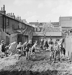 Boys creating an allotment on a bomb site in London, 1942