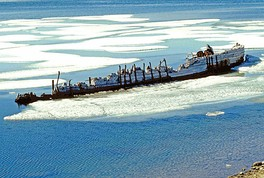 The remains of Amundsen's last ship, Maud, in Cambridge Bay (Victoria Island), where it sank in 1930. 69°7′8.28″N 105°1′11.61″W / 69.1189667°N 105.0198917°W / 69.1189667; -105.0198917