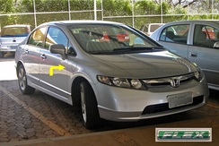 The Brazilian 2008 Honda Civicflex-fuel has outside access to the secondary reservoir gasoline tank in the front right side shown by the arrow.
